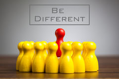 Be Different concept with pawn figurines on table Stock Images