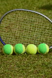 Be different. A tennis ball, solid, poses in a straight line with several balls used in children's tennis training, which are of two colors. The background of royalty free stock photography