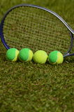 Be different. A tennis ball, solid, poses in a straight line with several balls used in children's tennis training, which are of two colors. The background of stock photo