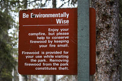 Be Environmentally Wise sign asking to conserve wood.  Stock Image