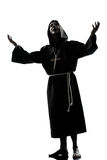 Be för silhouette för manmonkpräst Royaltyfri Foto
