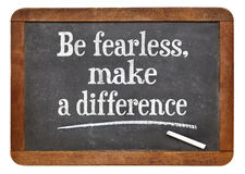 Be fearless, make a difference. Motivational text  on a vintage slate blackboard Stock Images
