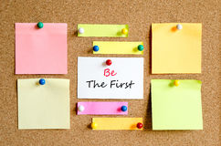 Be the first text concept. Sticky note on cork board background and text concept Royalty Free Stock Photography