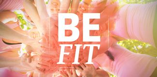 Composite image of be fit. Be fit against smiling women organising event for breast cancer awareness Stock Images
