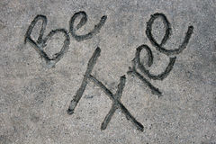 Be Free. Is written in a concrete sidewalk Royalty Free Stock Photography