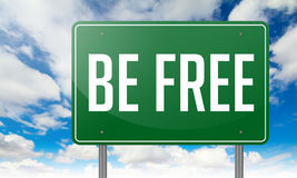 Be Free on Green Highway Signpost. Royalty Free Stock Photo