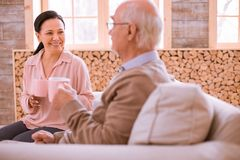 Positive delighted Asian woman having pleasant talk royalty free stock images