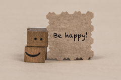 Be happy card with cube smiley icon Stock Image