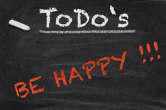 Be happy Chalkboard. High resolution black chalkboard image with happiness as only thing on to do list. Conceptual illustration to focus on really important Royalty Free Stock Photos