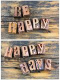 Be happy days greeting letterpress sign. Be happy days concept fun message people greeting inspiration sign barn wood background letterpress type letters words stock photos