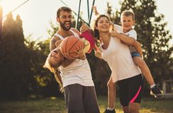 Be always happy. Family on basketball court royalty free stock photography