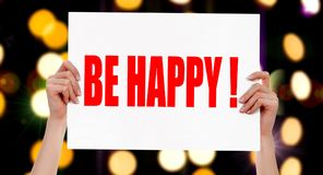 Be Happy! Female hands holding a placard Stock Images