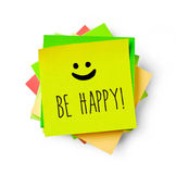 Be happy message on adhesive note Royalty Free Stock Photography