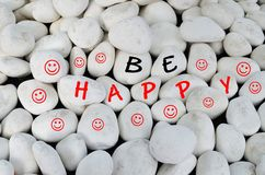 Be happy message over white stones Stock Photography