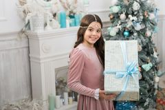 Be happy. pretty little princess celebrate christmas. big present box for cute child. happy new year to you. thank you