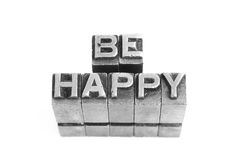 Be Happy sign, antique metal letter type Royalty Free Stock Photos