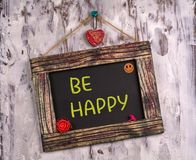 Be happy written on Vintage sign board royalty free stock photography