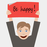 Be happy. Young man holds poster with text be happy Stock Images
