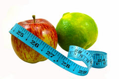 Be Healthy. Image of apple and orange with measuring tape displaying how to be healthy Stock Image