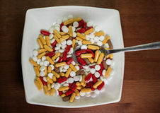 Be healthy. Treatment with pills. Many pills in the plate with s Stock Photos