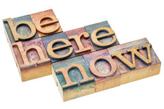 Be here and now in wood type Royalty Free Stock Image