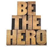 Be the hero in wood type. Be the hero - isolated text in letterpress wood type stock image