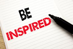 Be Inspired. Business concept for Inspiration and Motivation written on notebook with copy space on book background with marker pe. Be Inspired. Business concept Stock Photo