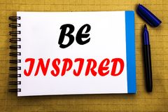 Be Inspired. Business concept for Inspiration and Motivation Written on notepad note paper background with space office view with. Be Inspired. Business concept Stock Photos