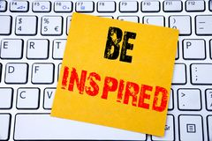 Be Inspired. Business concept for Inspiration and Motivation written on sticky note paper on the white keyboard background. Be Inspired. Business concept for Royalty Free Stock Images