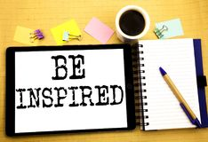 Be Inspired. Business concept for Inspiration and Motivation Written on tablet laptop, wooden background with sticky note, coffee. Be Inspired. Business concept Stock Image