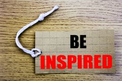 Be Inspired. Business concept for online saleInspiration and Motivation written on price tag paper with copy space on the wooden v. Be Inspired. Business concept Royalty Free Stock Photo
