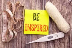 Be Inspired. Business fitness health concept for Inspiration and Motivation written sticky note empty paper background with copy s. Be Inspired. Business fitness Stock Images
