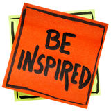 Be inspired reminder note. Be inspired reminder - inspirational handwriting on an isolated sticky note Stock Photo