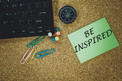 BE INSPIRED. Words on green note Royalty Free Stock Photo