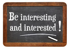 Be interesting and interested. Social media reminder and concept - white chalk text on a vintage slate blackboard stock photo