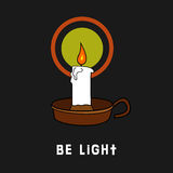 Be light. Candle, burning in the dark with the words Be a light Stock Photo