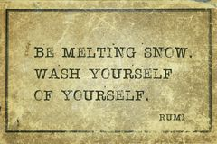 Be melting snow Rumi. Be melting snow. Wash yourself of yourself - ancient Persian poet and philosopher Rumi quote printed on grunge vintage cardboard stock photo