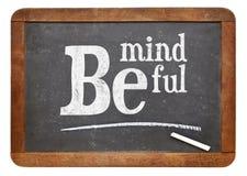 Be mindful blackboard sign. Be mindful sign - motto or resolution on a vintage slate blackboard Royalty Free Stock Image