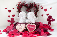 Be Mine. Cherubs with cupids and cererim hearts that state 'be Mine' and rose petels Stock Photos