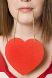 Be Mine. Woman holds a blank heart from her mouth -- add your own message stock images