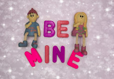 Be mine.... Be mine, message in red and pink lettering with thinking girl and boy Stock Photos
