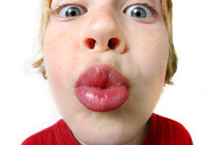 Be Mine. An extreme close-up on a young boys lips as he offers a kiss Stock Photo