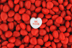 Be Mine Candy on Top of Small Valentine Candies Royalty Free Stock Photography