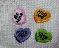 Be mine, hug me, kiss me and I love you embroideries Royalty Free Stock Photography