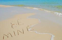 Be Mine Written on Beach. Be Mine Written in Sand on Beach Near Pretty Ocean Surf Royalty Free Stock Photos