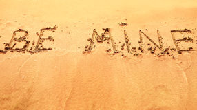 Be mine written on sand on beach Stock Photography