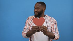 Free Be My Girlfriend! I Love You! Portrait Of Tenderromantic Sweet Lovely African Man Showing Big Red Heart In Hands Royalty Free Stock Images - 160719809