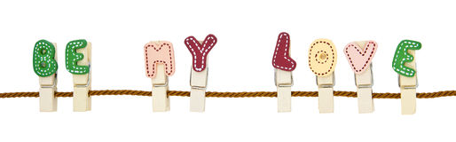 Be My Love word clip. English alphabet wooden clip on the rope royalty free stock photo