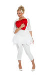 Be my valentine. Pretty blond girl with big red valentine heart against her chest Royalty Free Stock Image