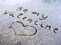 Be My Valentine. Text with heart drawn on the snow Royalty Free Stock Photo